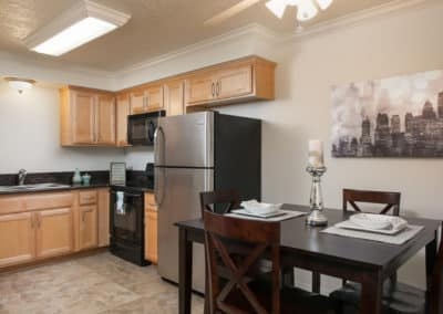 Kitchen with dining table, maple cabinets