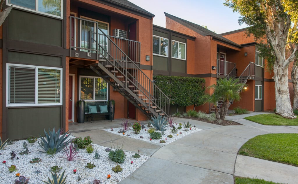 Orange two story building with olive green accents